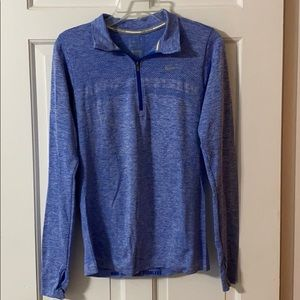 a dry-fit three-quarter zip running top